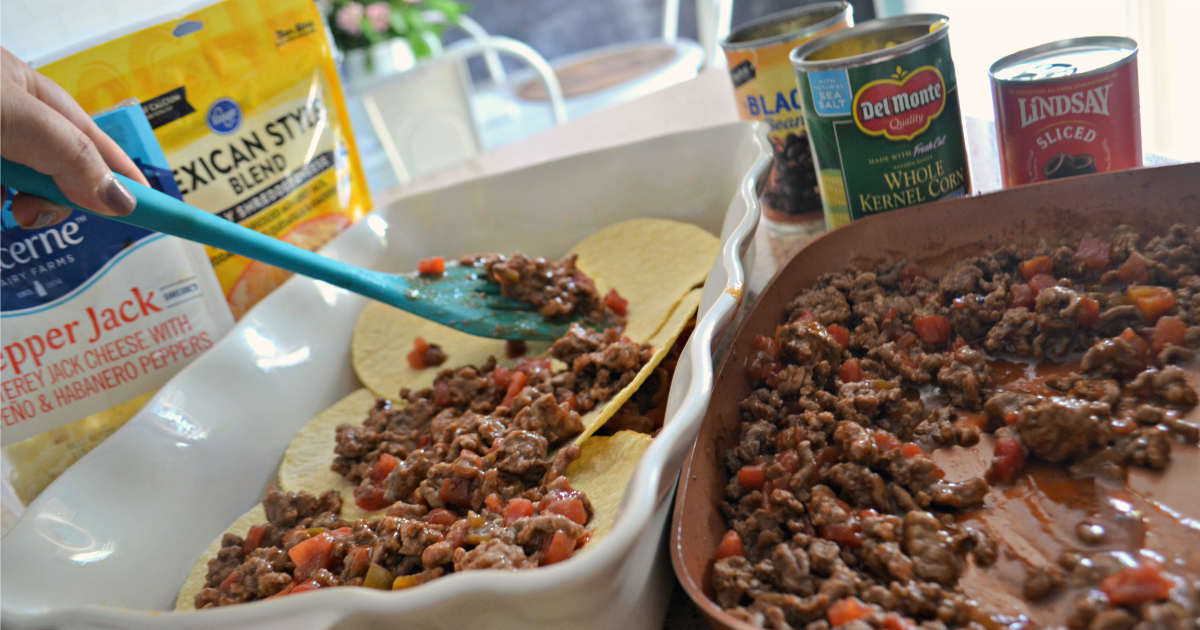 Easy Mexican Lasagna - Spooning meat onto the shells