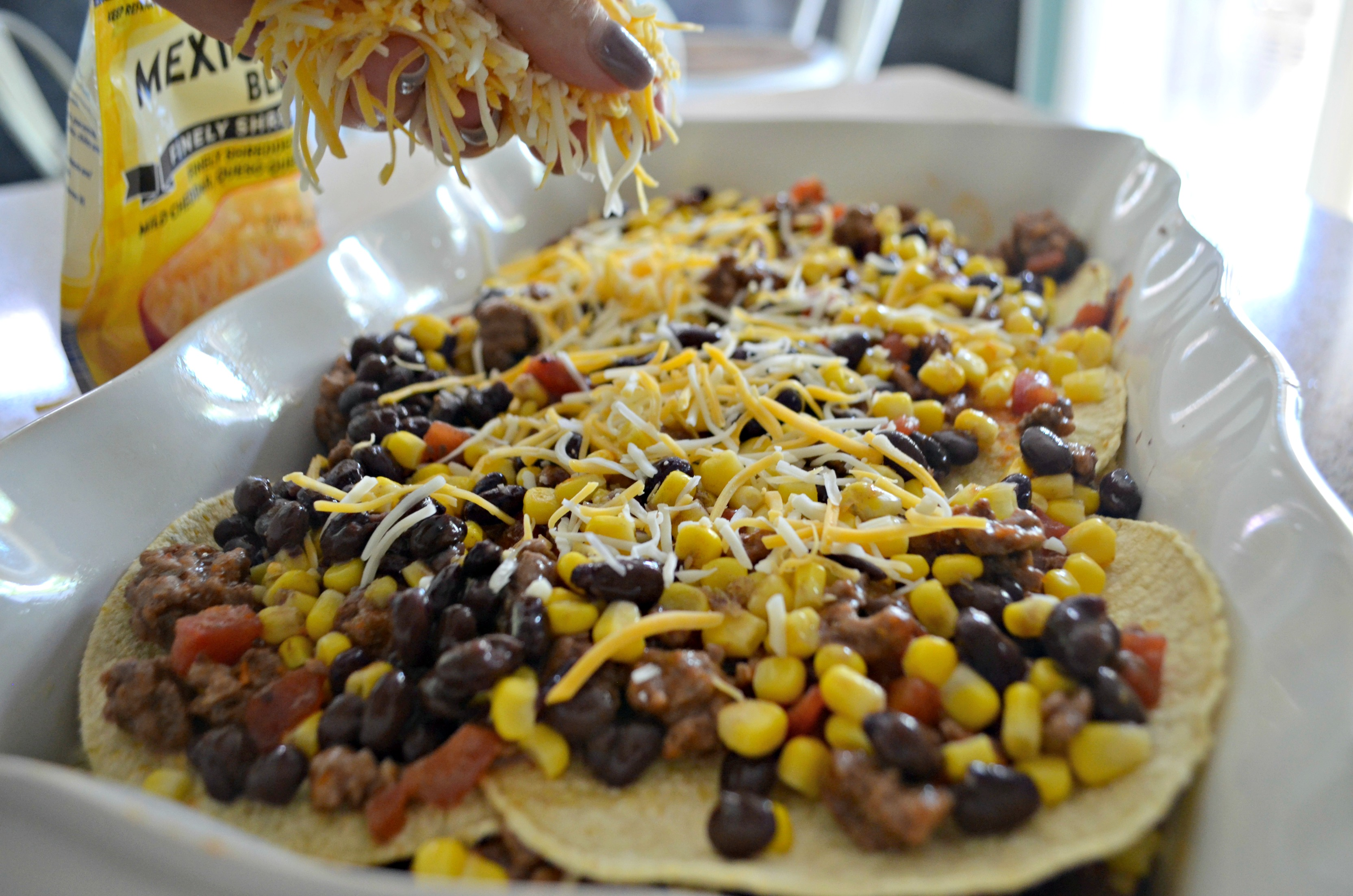Easy Mexican Lasagna - adding shredded cheese