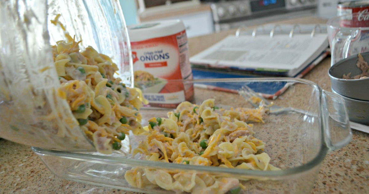 tuna noodle casserole is one of our favorite childhood recipes – Here, pouring ingredients into the baking dish