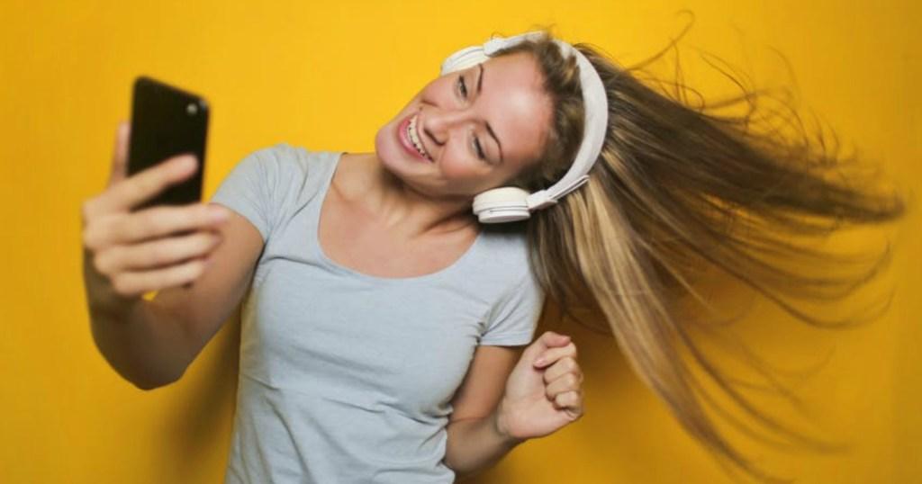 girl dancing with headphones on