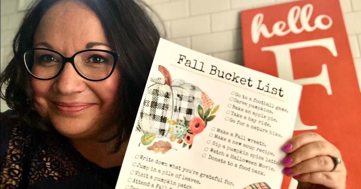 free printable fall bucket list - lina holding her bucket list