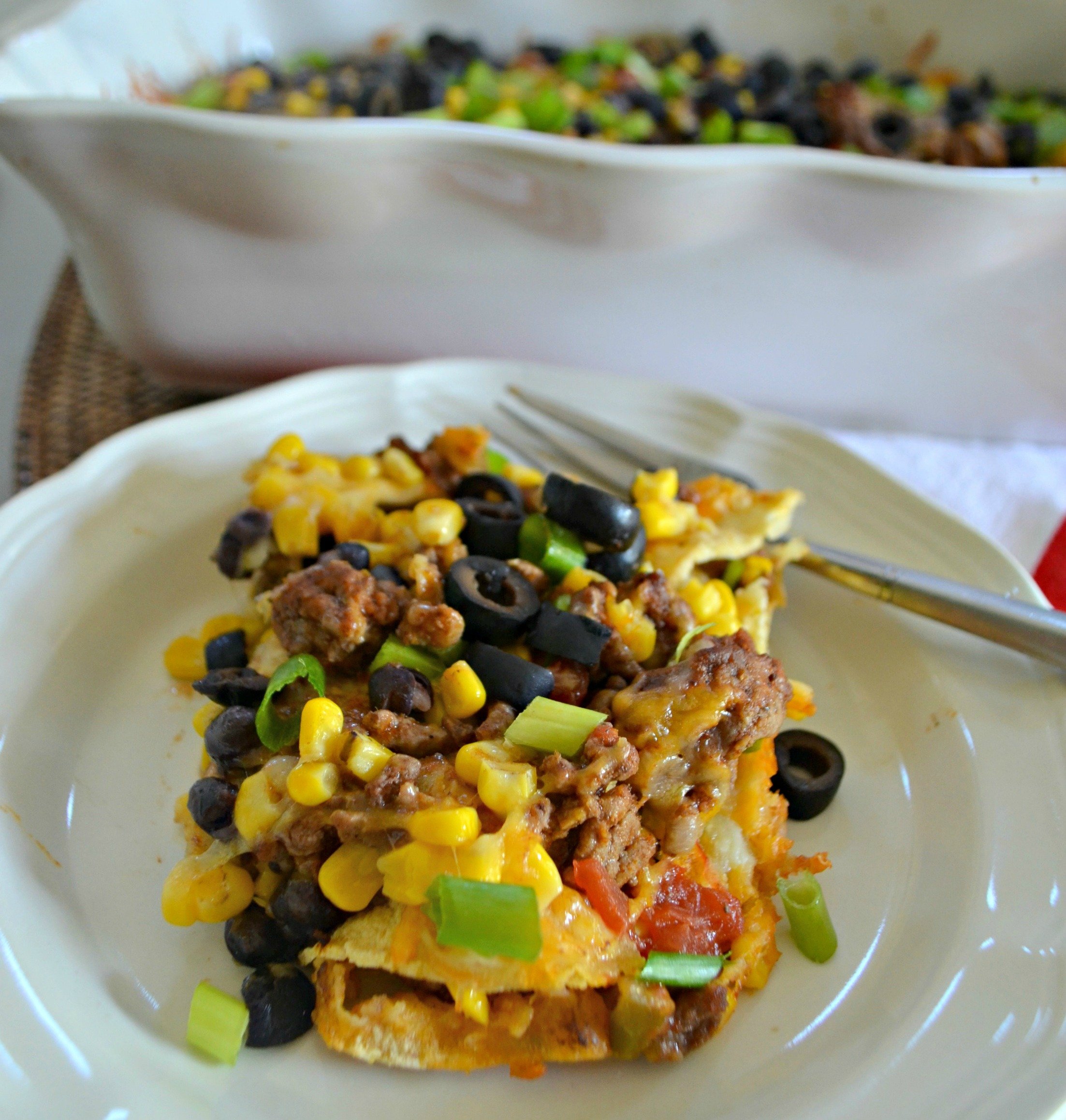 Easy Mexican Lasagna - closeup of the lasagna served on a plate