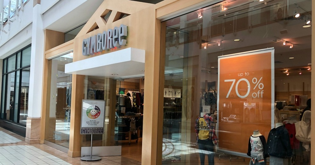 gymboree store front with sale signage