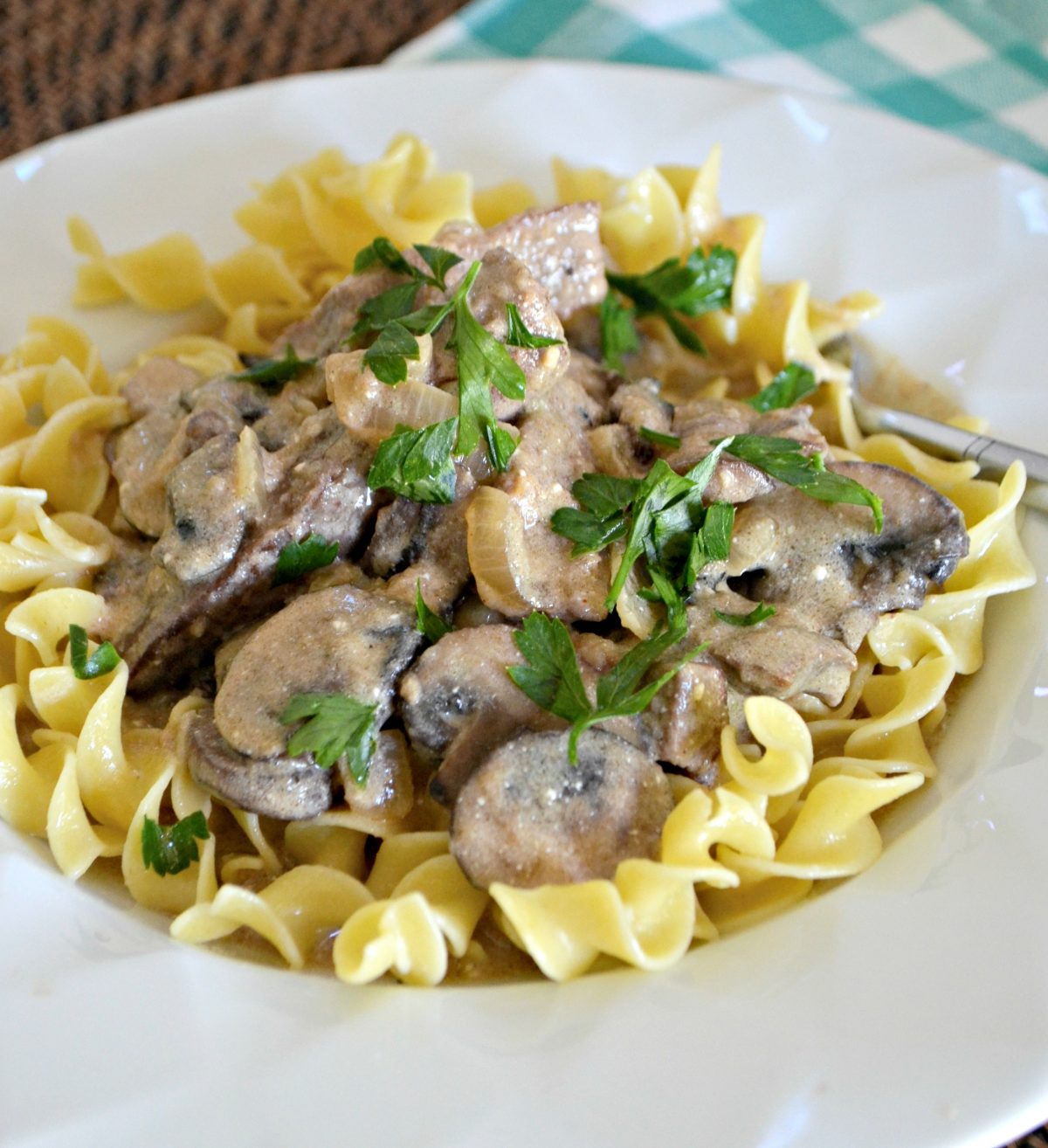 classic beef stroganoff is one of our favorite childhood recipes – plated with parsley