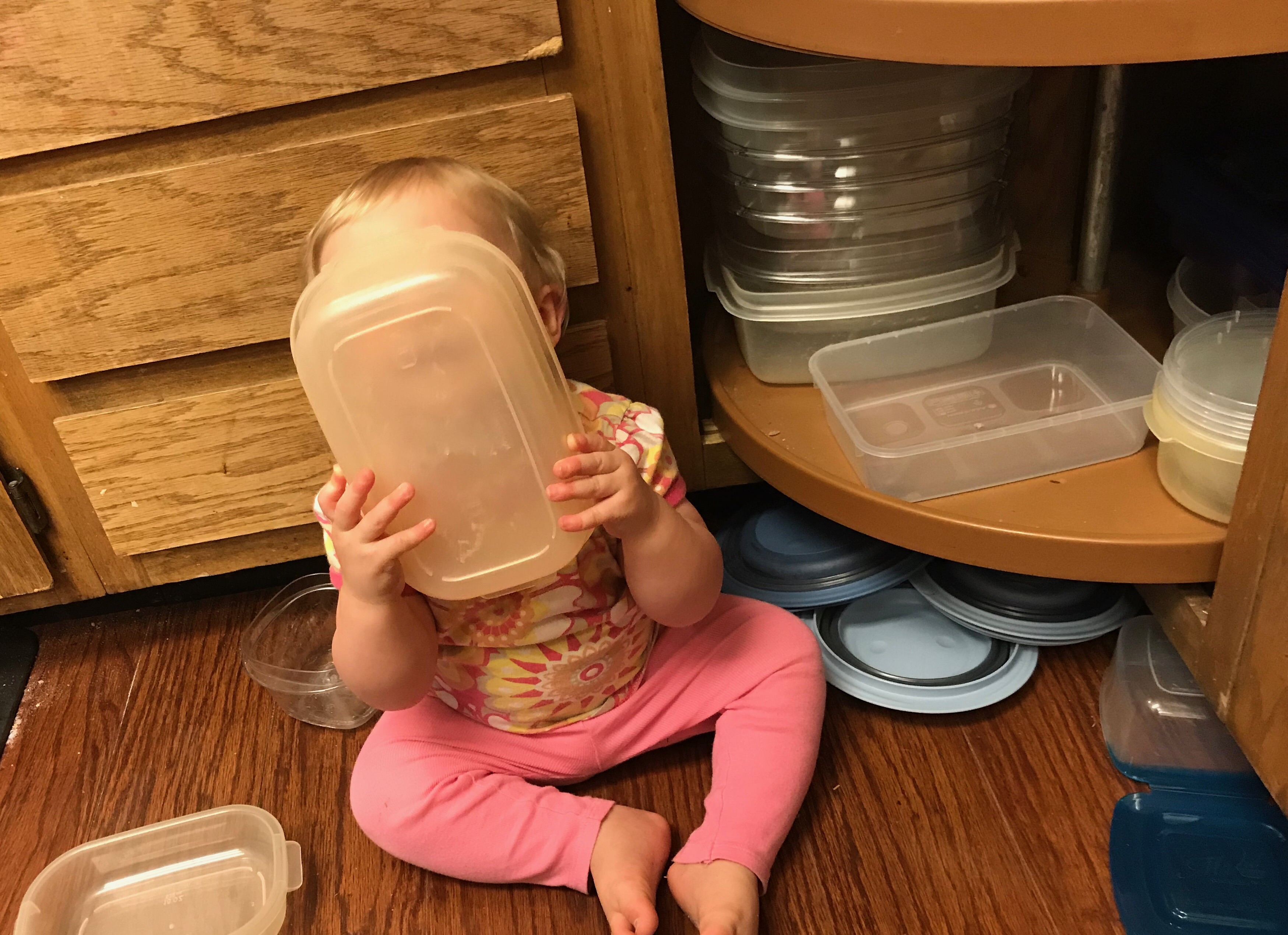 favorite baby proofing products from munchkin – Stacy's own munchkin playing with plastic containers