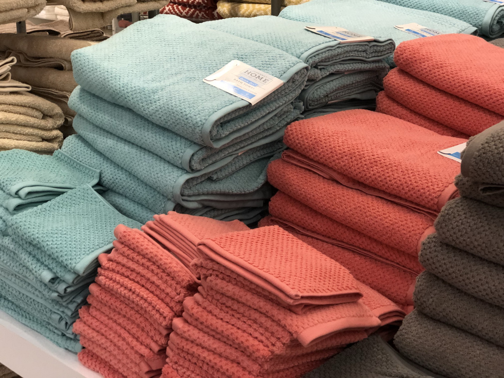 pile of bath towels in store