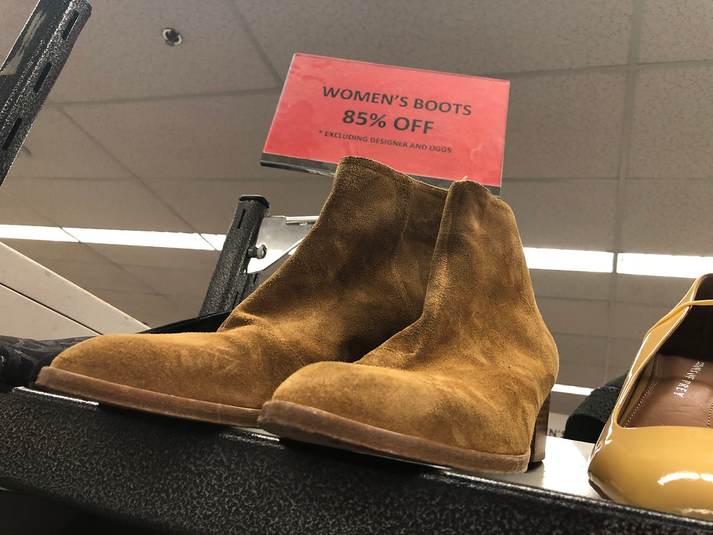 nordstroms last-chance store deals, tips, and tricks – sign showing women's boots 85% off