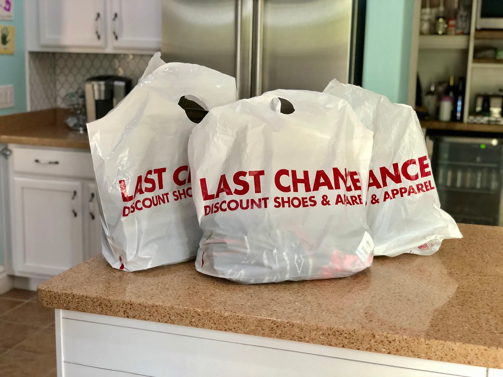 nordstroms last-chance store deals, tips, and tricks – Last Chance bags on a counter