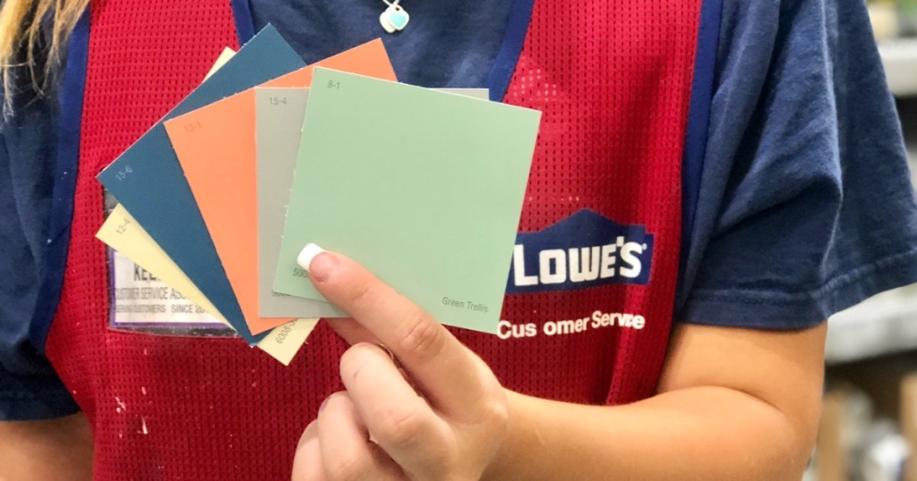 woman at Lowe's holding paint samples