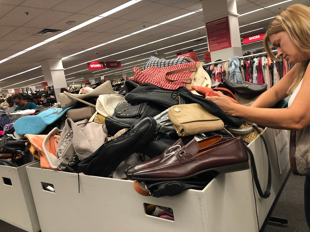nordstroms last-chance store deals, tips, and tricks – woman searching in a bin