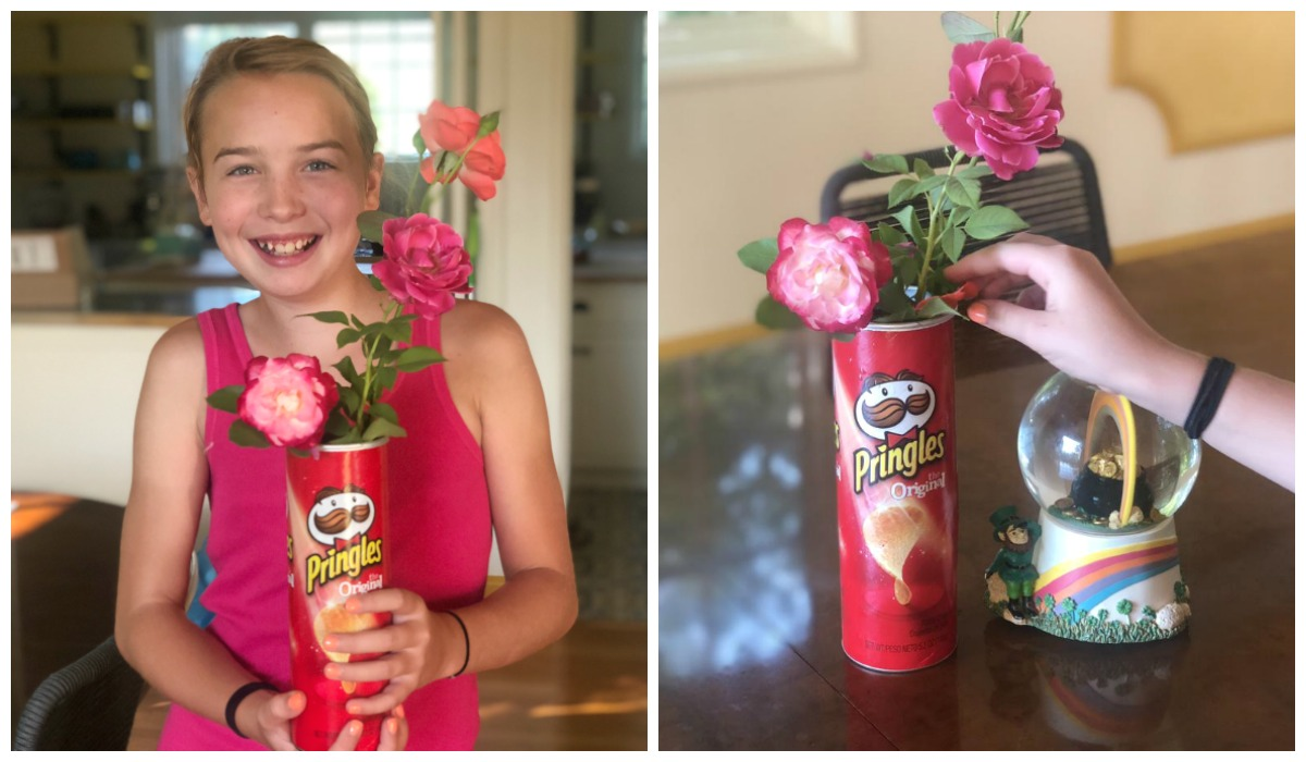 How moving made us feel grateful while having less – collin's daughter piper holding a pringles vase with flowers