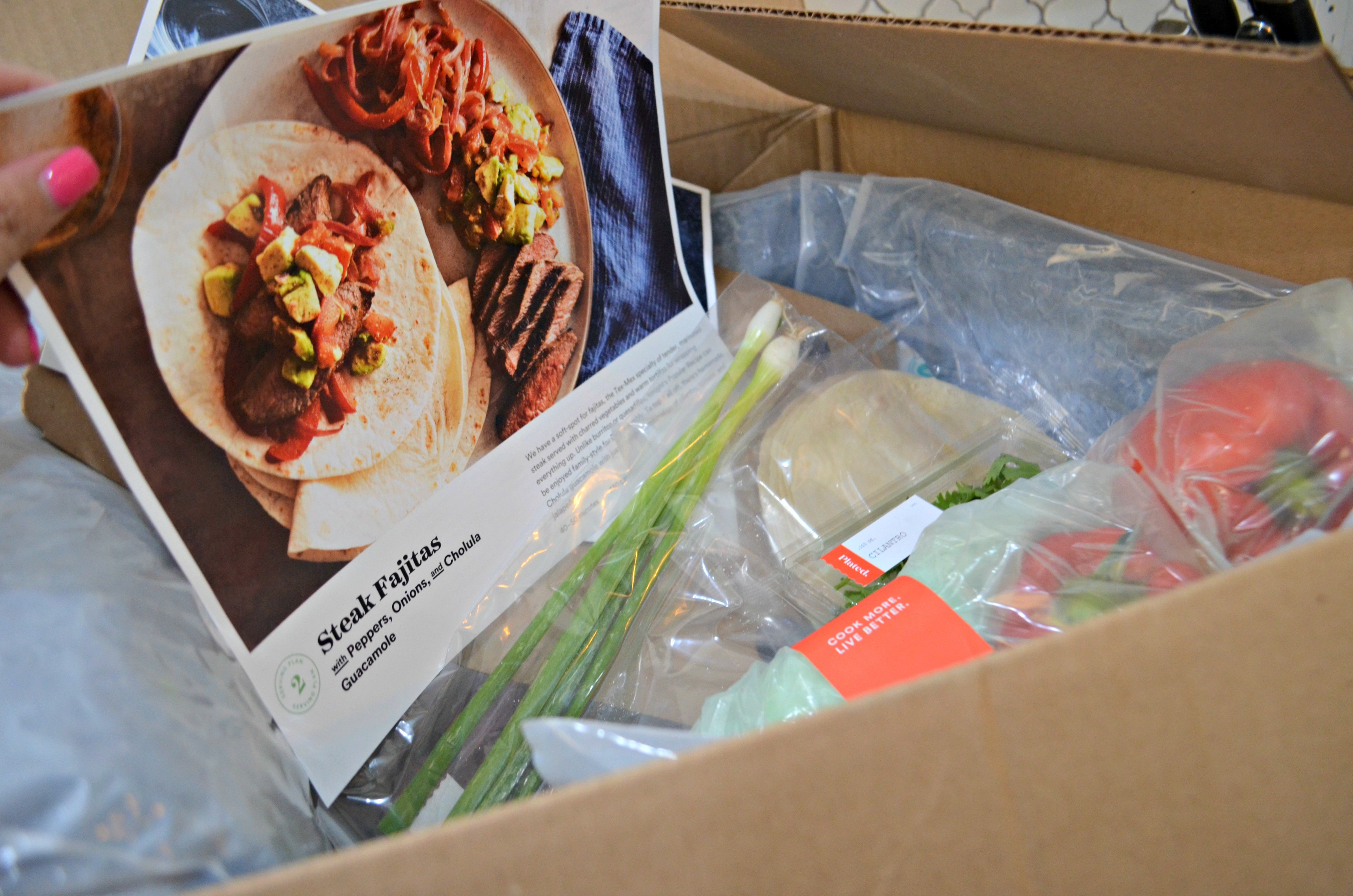 deal plated meal kit – Plated subscription box ingredients and recipe card for fajitas.