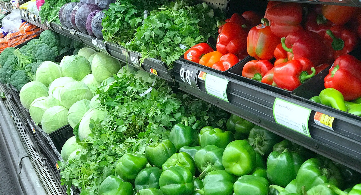 save money with these summer clearance sales – peppers and other produce in refrigerated bins