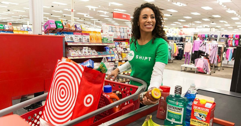 grocery services — shipt shopper checking out at target