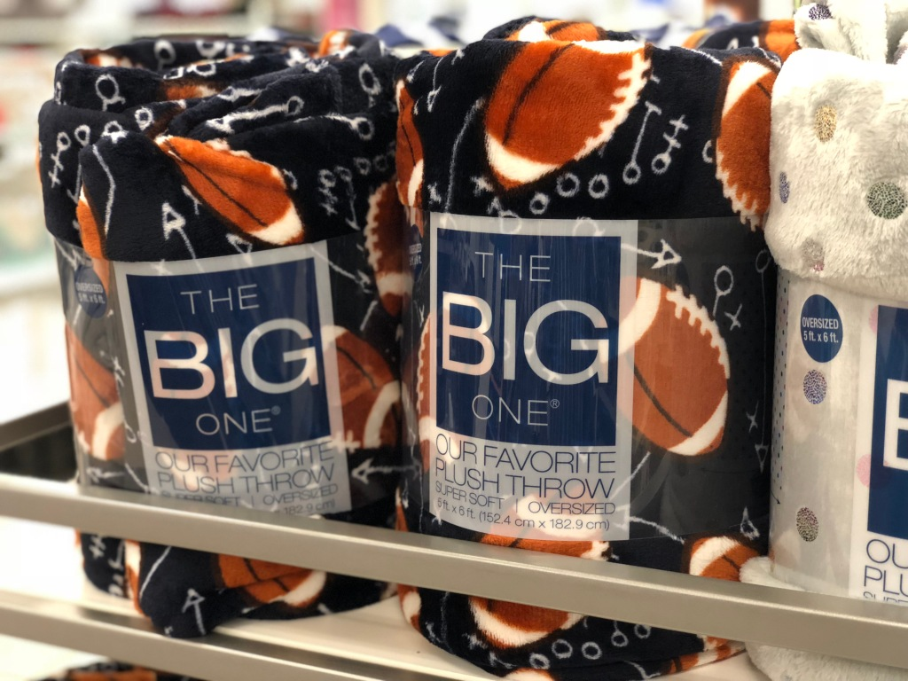 the big one football themed soft plush throw in store on shelf