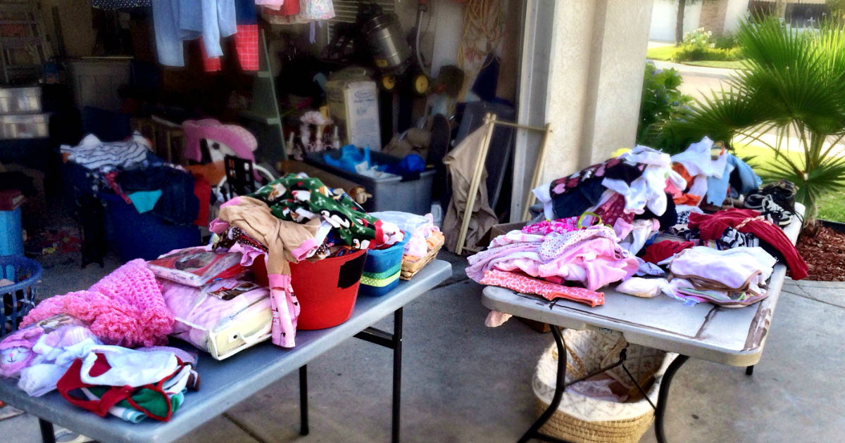 national garage sale day is upon us – tables with clothes laid out on them