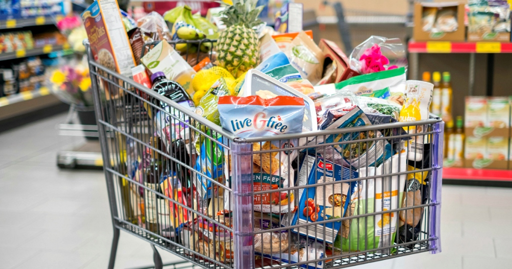 shopping cart filled with groceries - stock up by shopping sale cycles