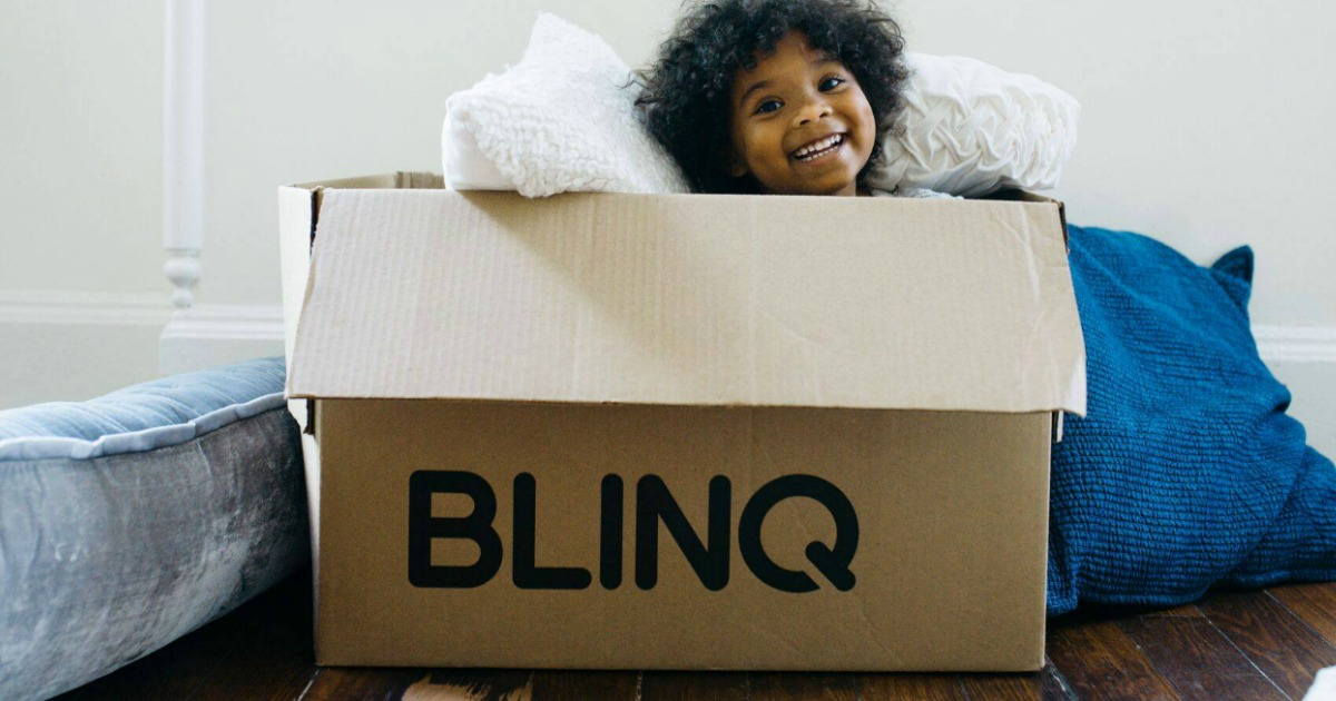 Girl smiling sitting in a BLINQ box