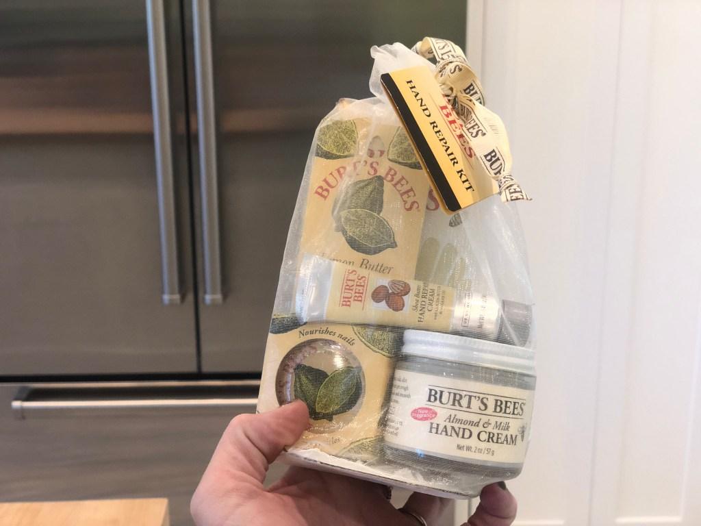 hand holding burts bees gift set