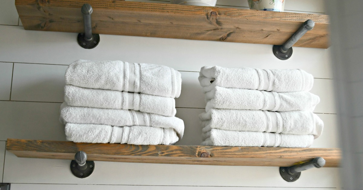 Costco Charisma Bath Towels Are Affordable & High-Quality – Stacked in a bathroom on shelves