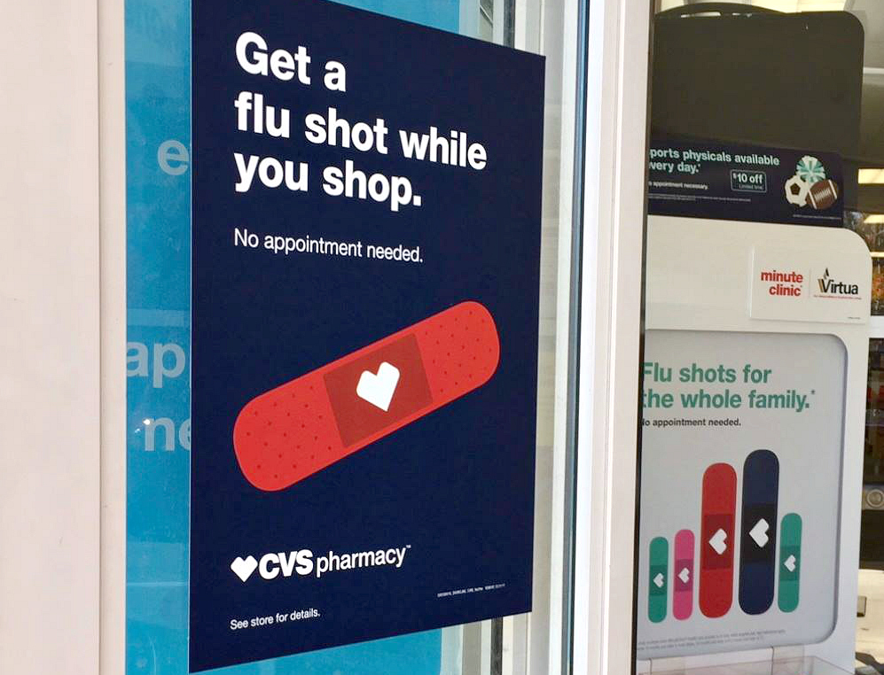 best places to save money on your flu shot vaccine – CVS pharmacy sign for flu shots