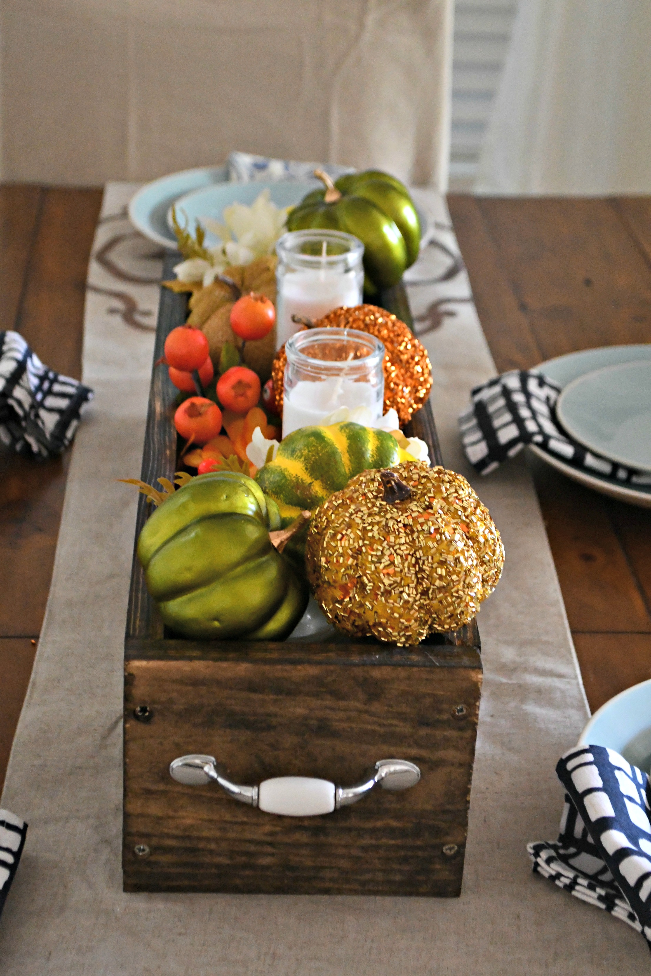 dollar tree fall centerpiece - one of my looks uses a fun assortment of pumpkins, greenery, and candles