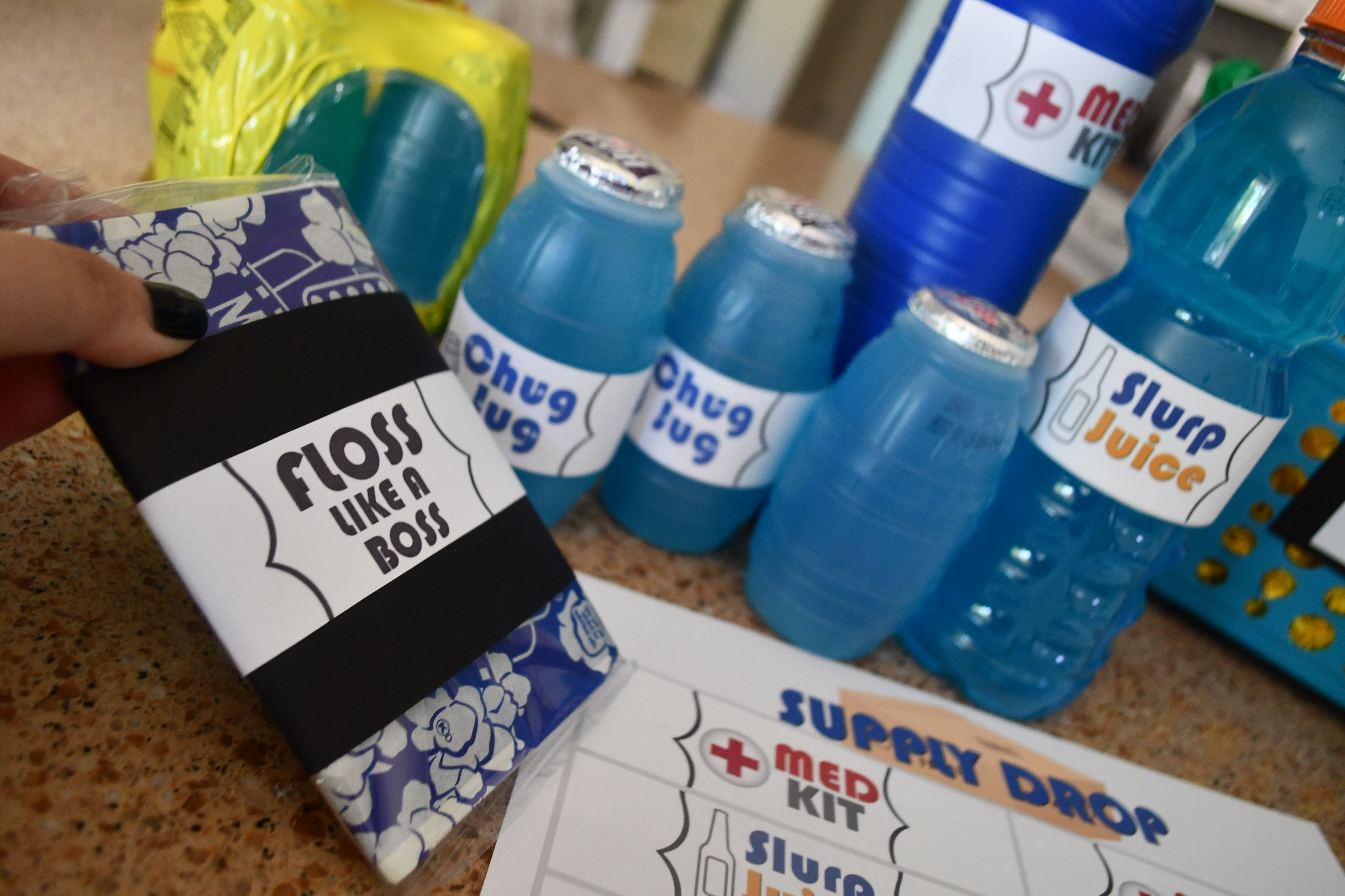 DIY Dollar Tree Fortnite Gift Basket items to place in the basket, including drinks and popcorn