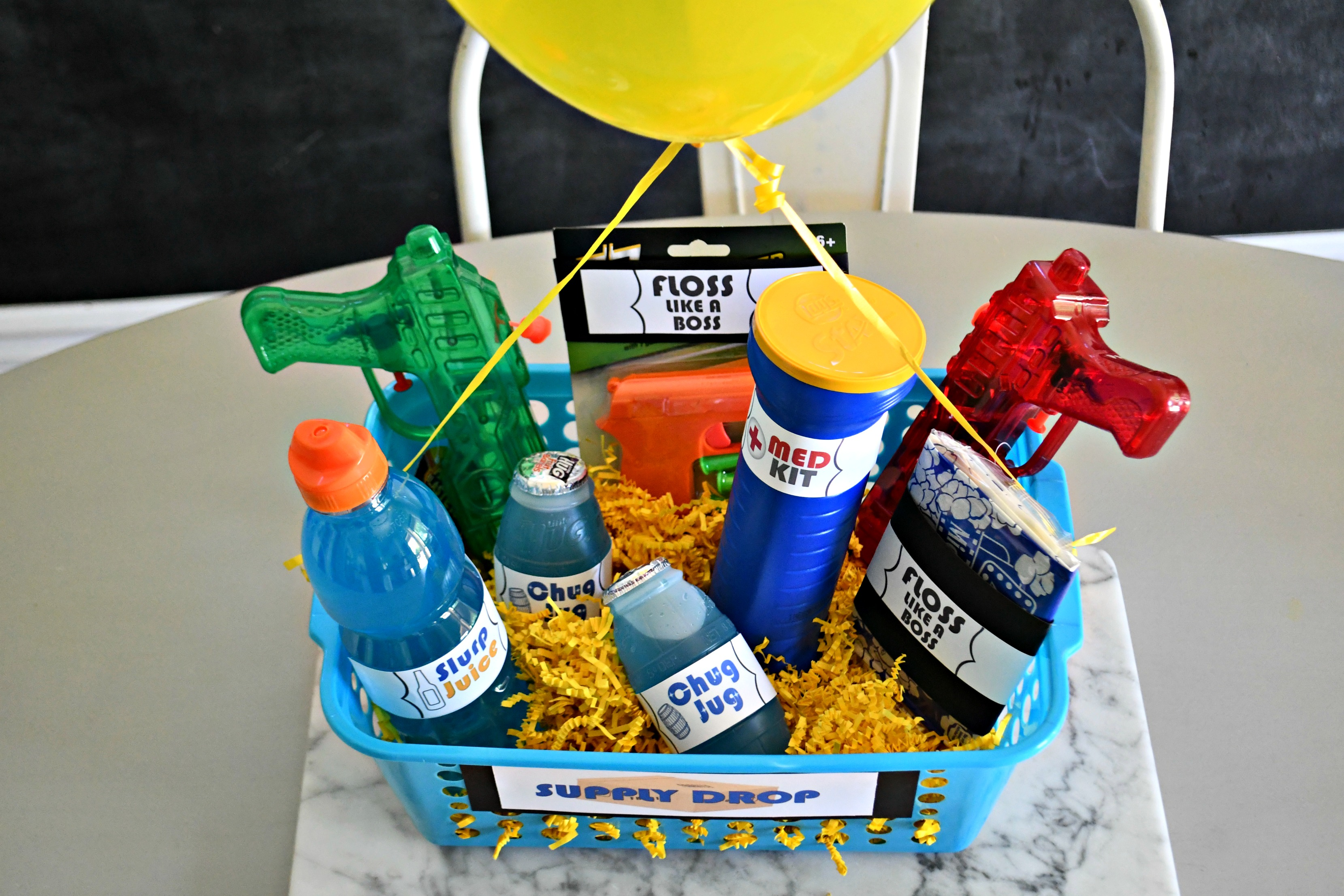DIY Dollar Tree Fortnite Gift Basket in the supply drop basket with the balloon attached