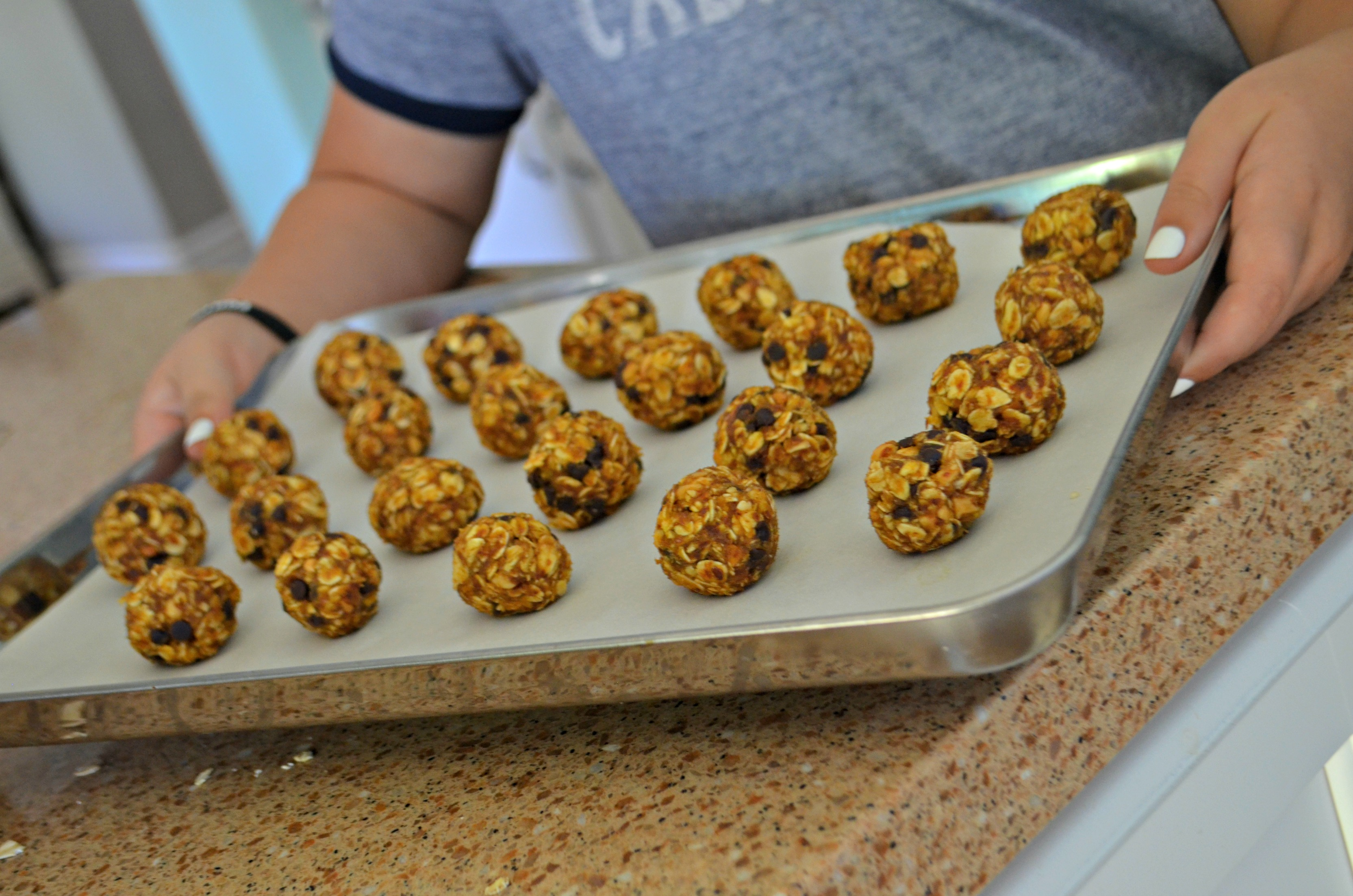 No-Bake Pumpkin Oatmeal Energy Bites rolled into balls on a baking sheet for cooling