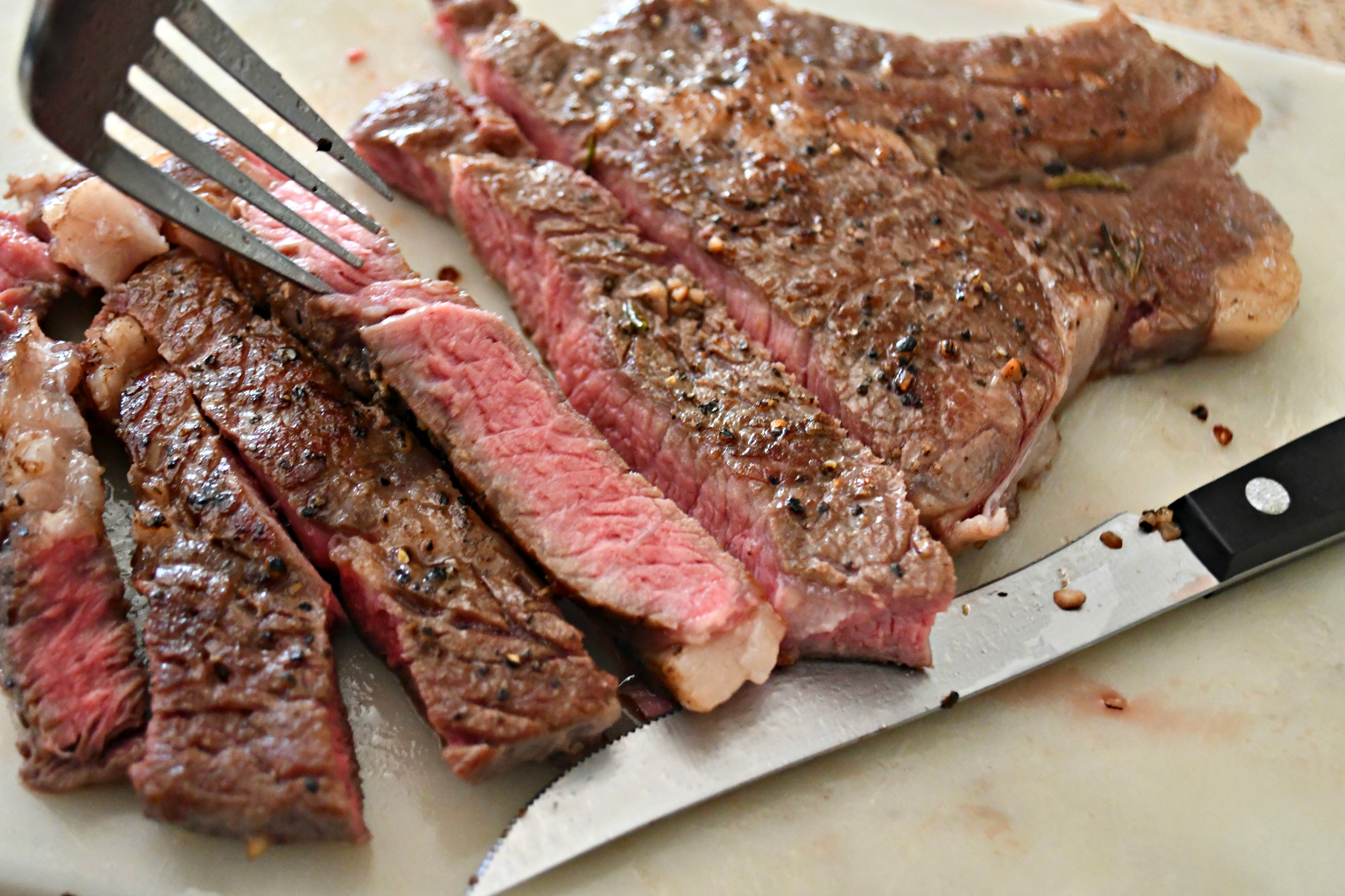 Make the Best Steak Using a Sous Vide! Sliced and served on a cutting board