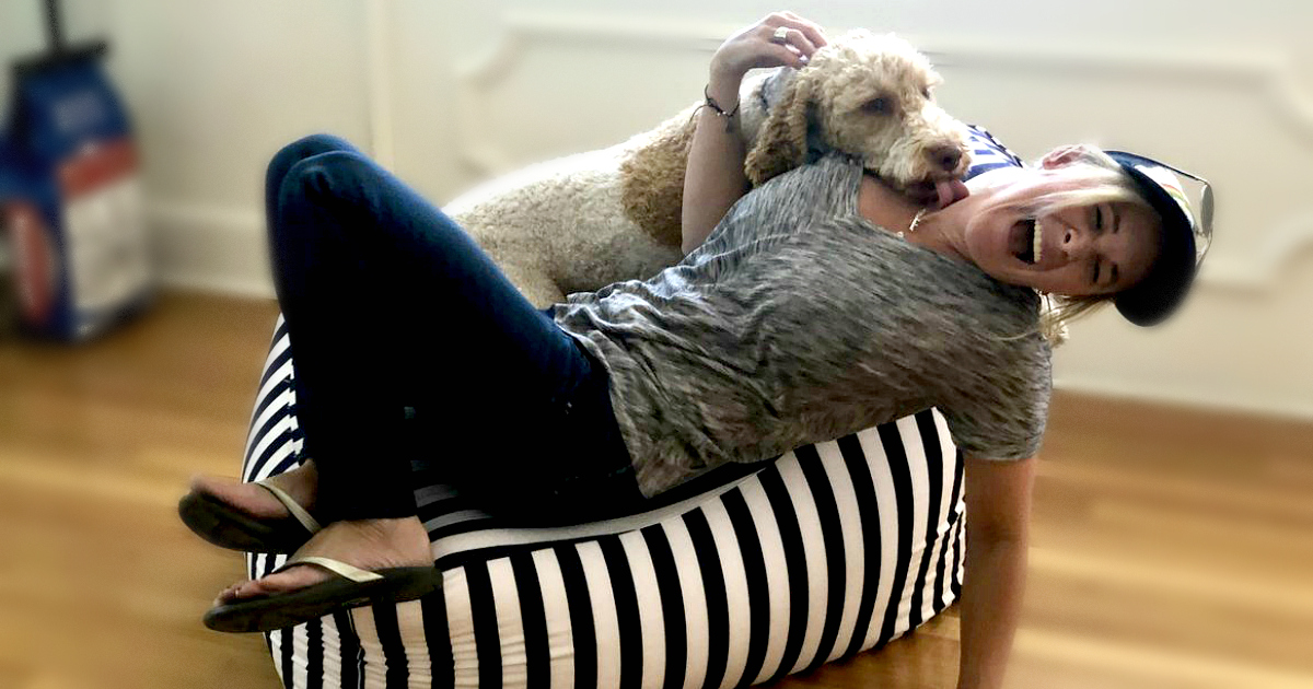 Enter to win (or score a great deal on) a Juniper Outdoor Bean Bag Chair - pictured here with Collin and her dog