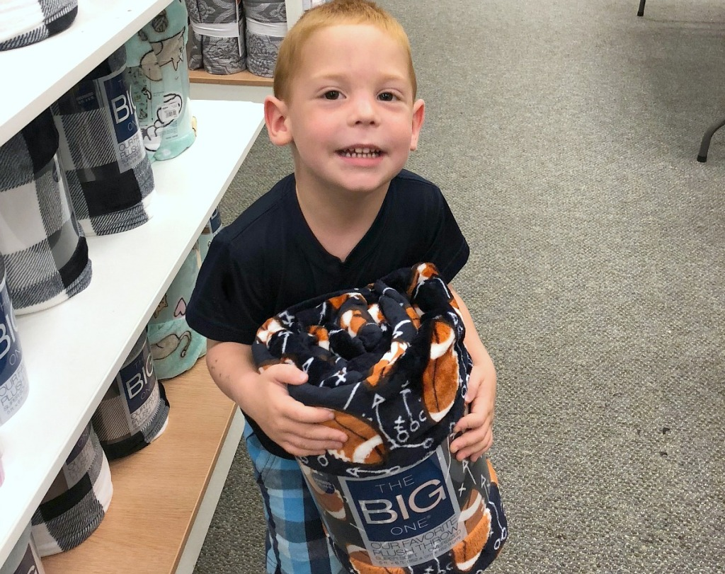 best blankets —erica's son holding his new The Big One blanket from Kohl's