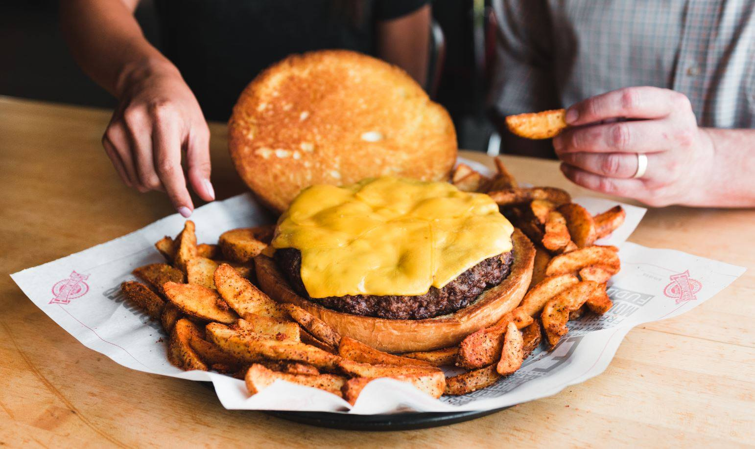 National Cheeseburger Day Deals 2018 - picture of a Fuddruckers 3-pound challenge