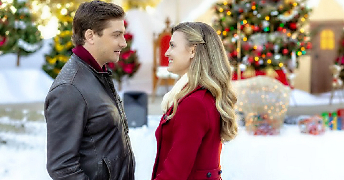 Hallmark Channel Holiday Movie schedule for 2018 – man and woman smiling at one another