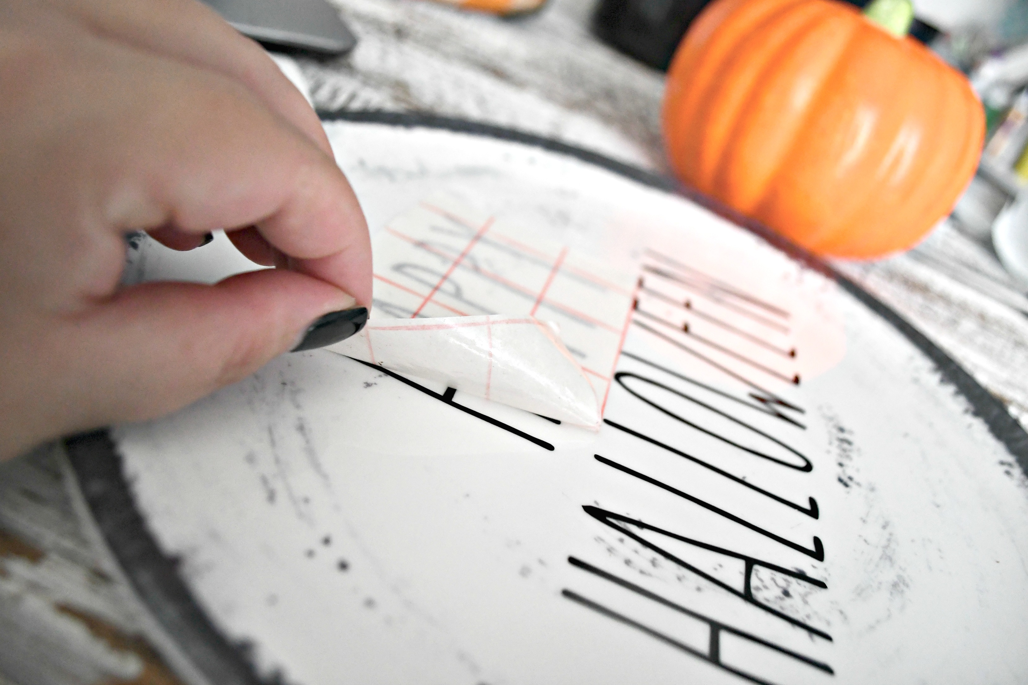 DIY Rae Dunn Inspired Halloween Decor - transferring the lettering to a plate