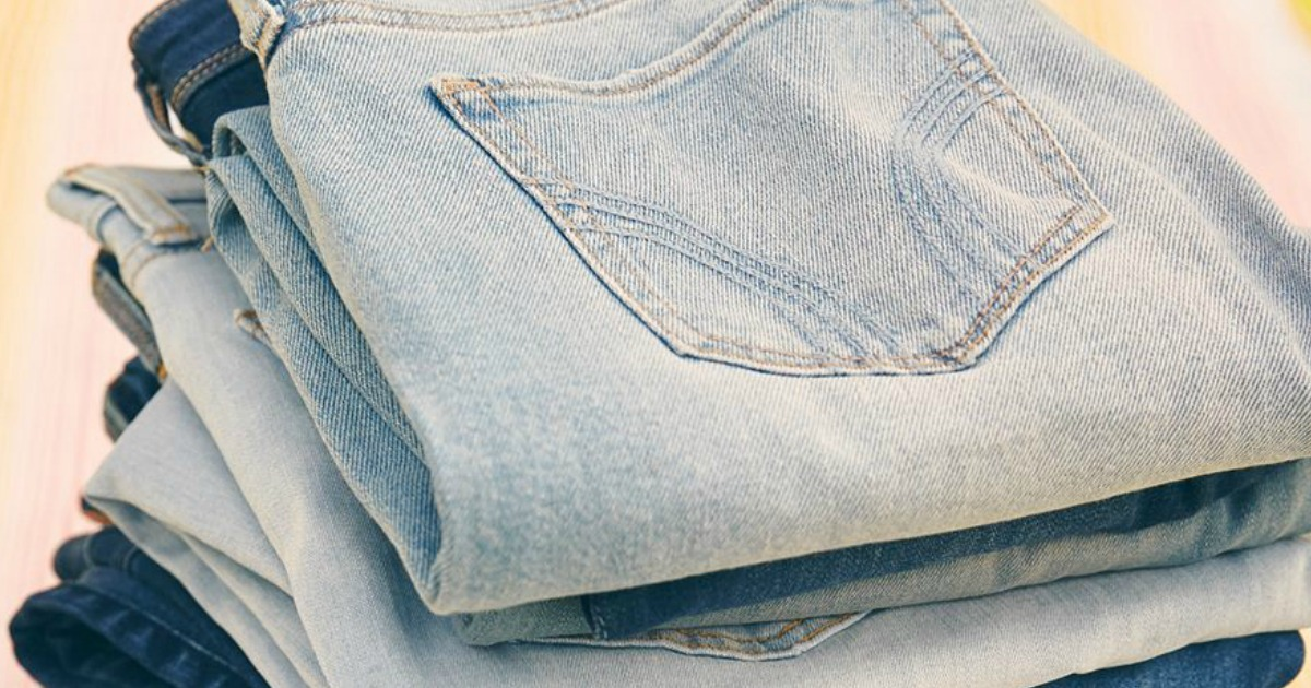 stack of folded jeans in varying shades