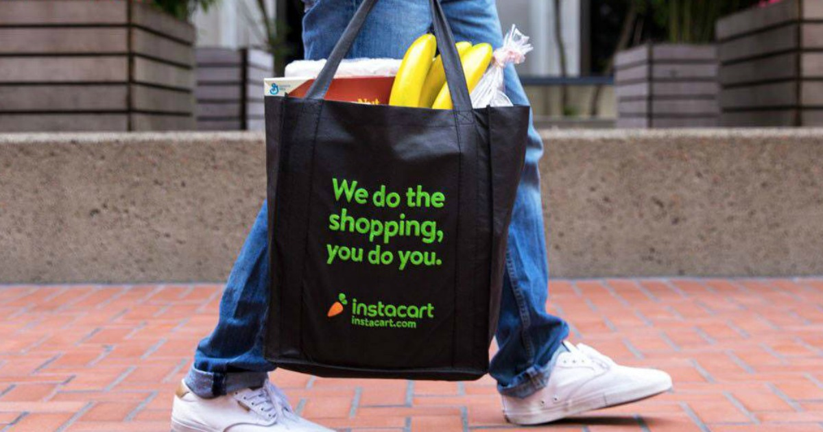person carrying instacart bag