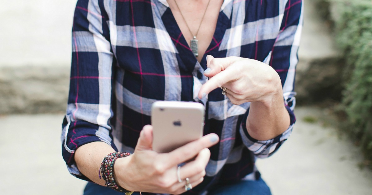 get text alerts with hot hip2save deals – Collin using her phone