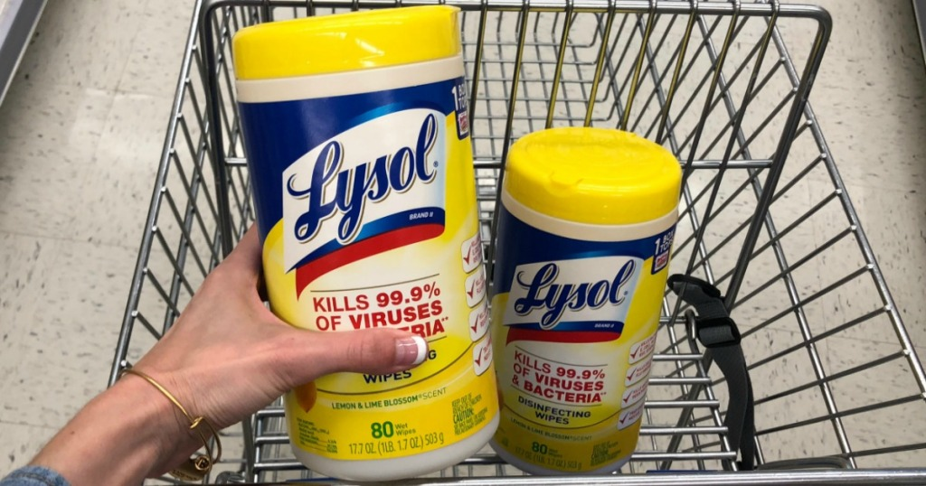 woman hand holding lysol lemon canister 80 count with additional canister in the cart