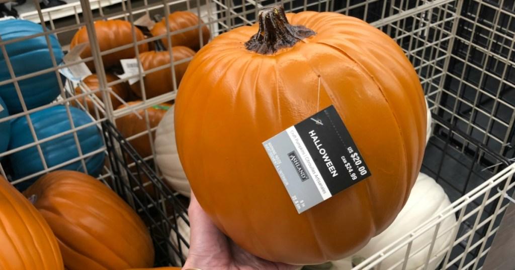 hand holding a craft pumpkin
