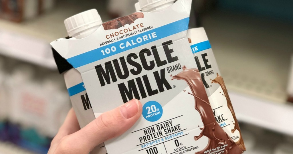 hand holding pack of Muscle Milk 100 calorie