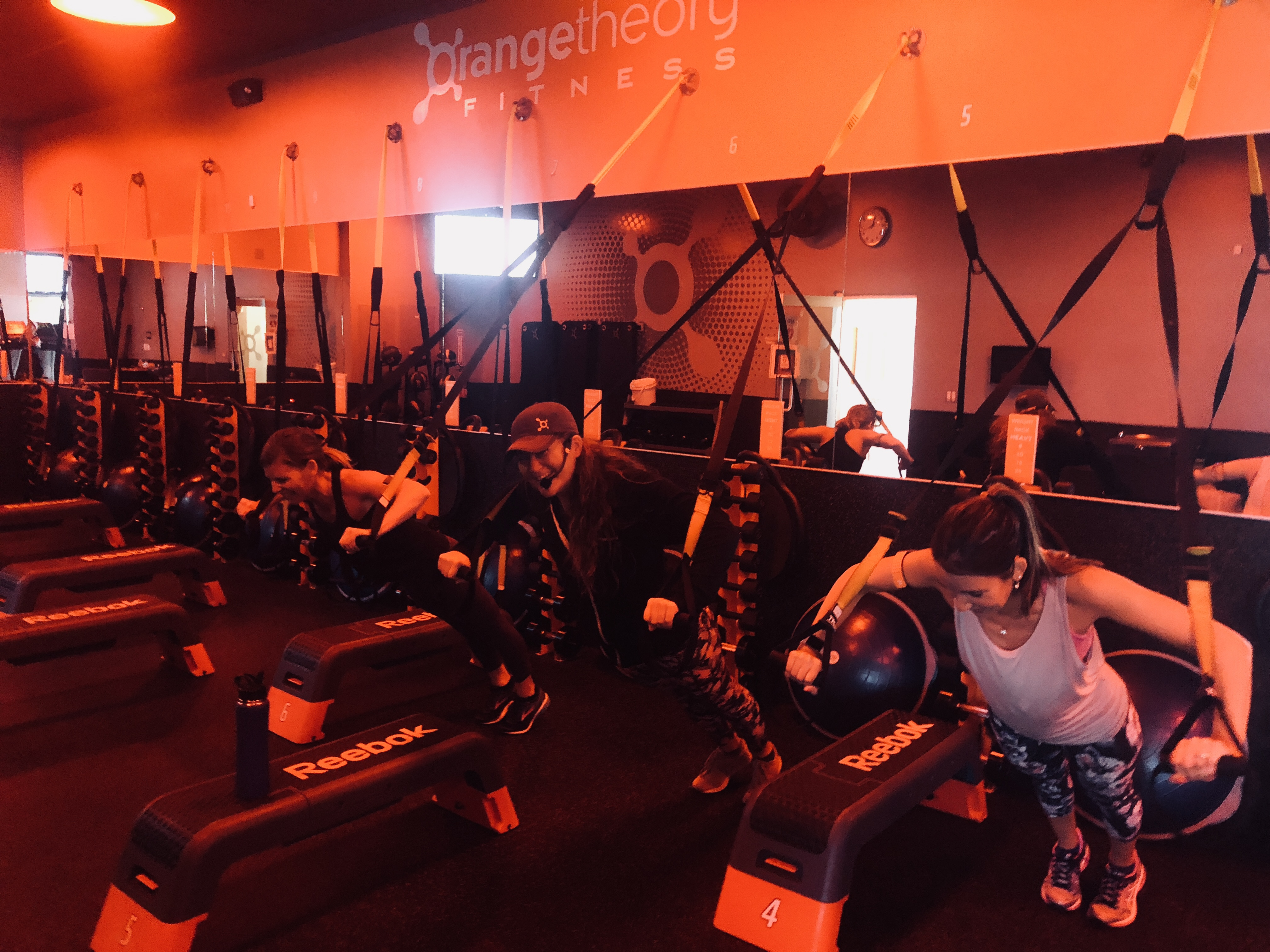 orangetheory fitness review – Erica working out with her instructor