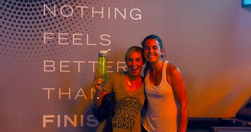 orangetheory fitness review – Bryn and Collin kicking up their foot