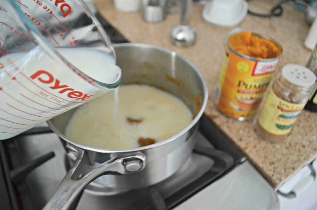 pouring milk into pumpkin puree