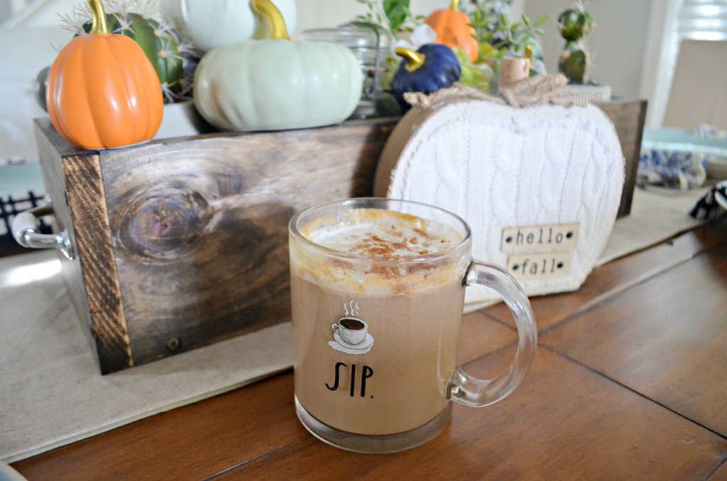 pumpkin spice latte on table with pumpkin centerpiece