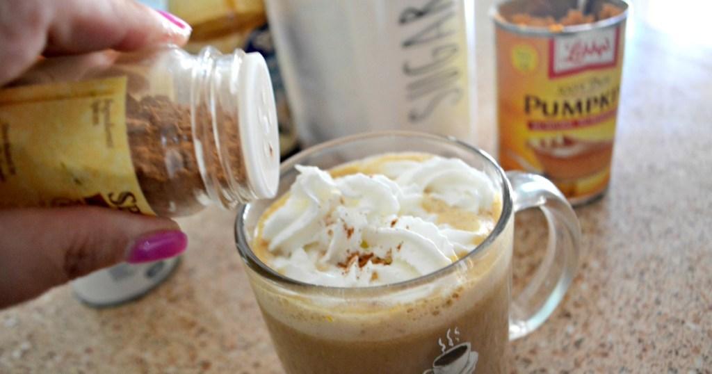 sprinkling on pumpkin pie spice to latte