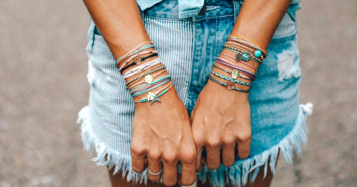 woman with lots of bracelets on her wrists