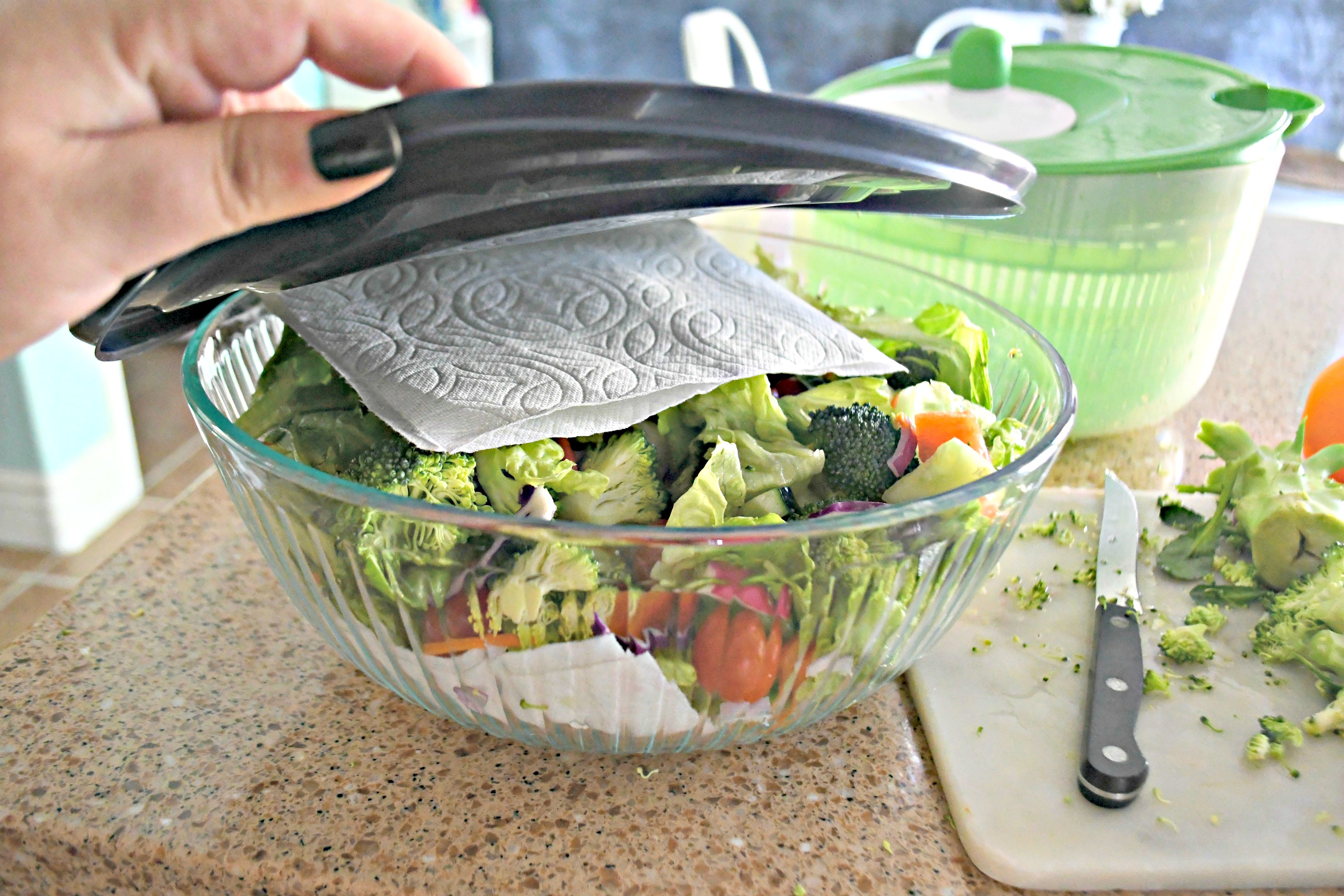 Storing my Weekly Sunday Salad Prep and my favorite dressing recipe in a glass storage container.