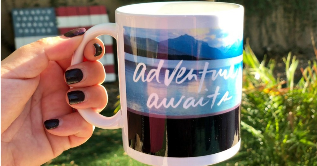woman holding a shutterfly coffee mug with adventure awaits on it