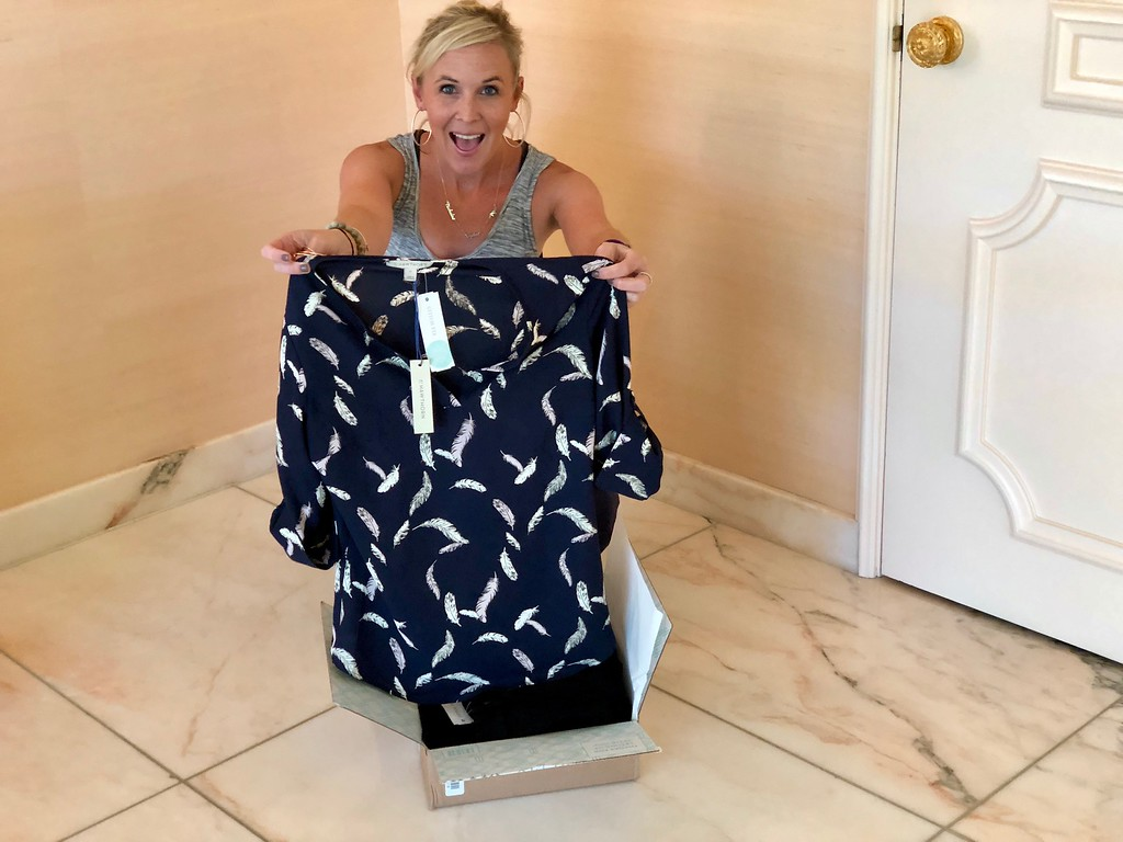 stitch fix women's gift subscription box makes shopping simple – Collin holding up a top